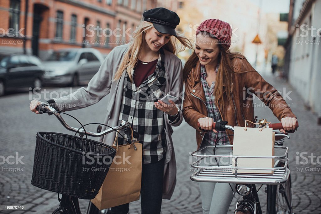 Young women looking at mobile phone stock photo