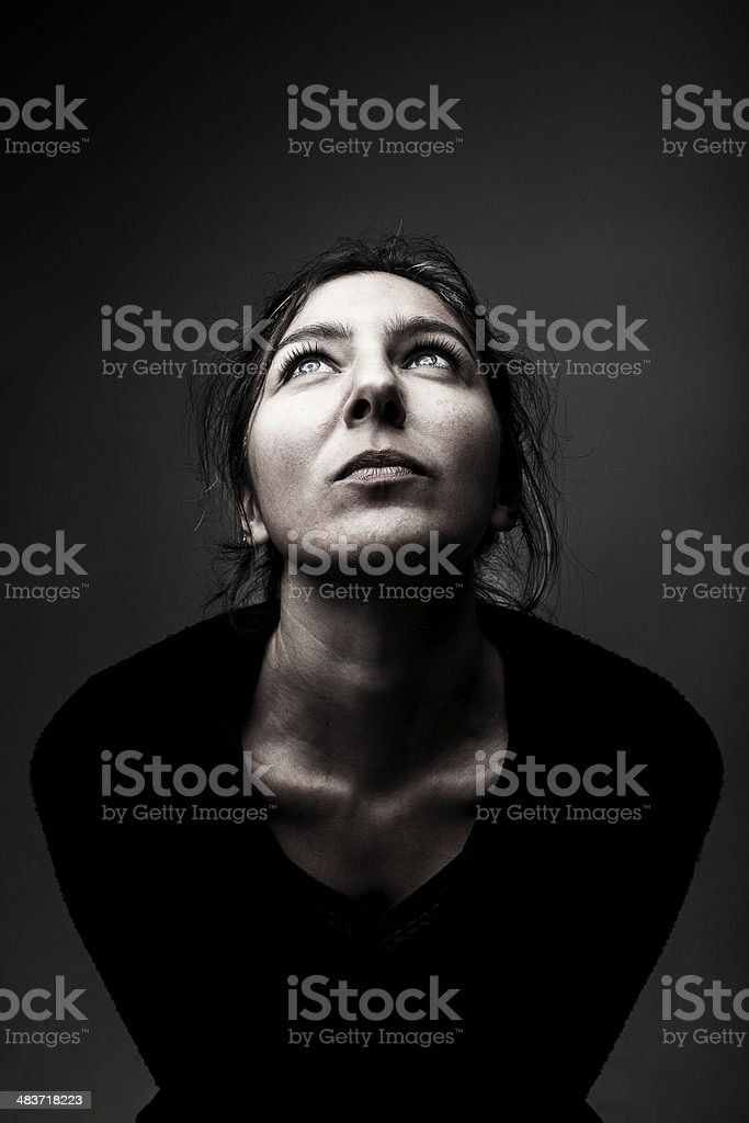 Young women looking up stock photo