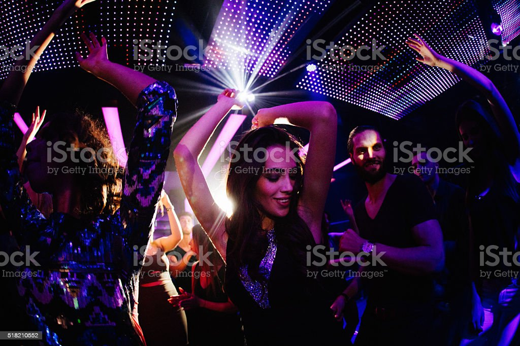 Young women loves dancing with friends in the club stock photo