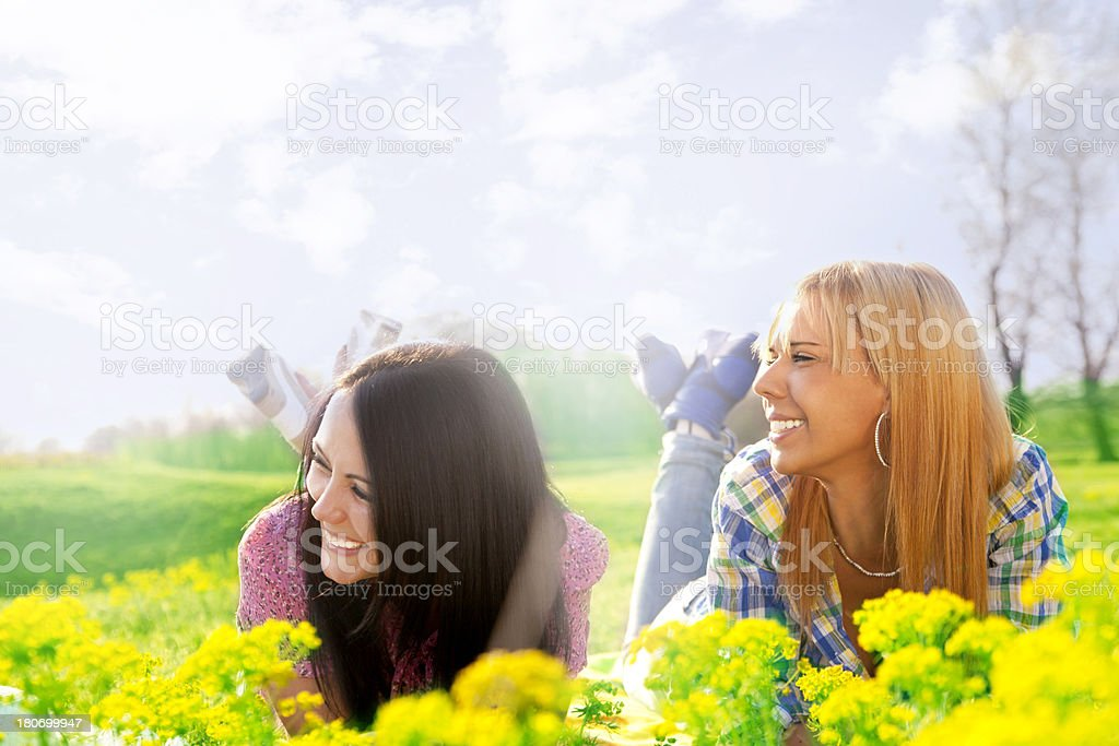 Young Women lying on the grass royalty-free stock photo