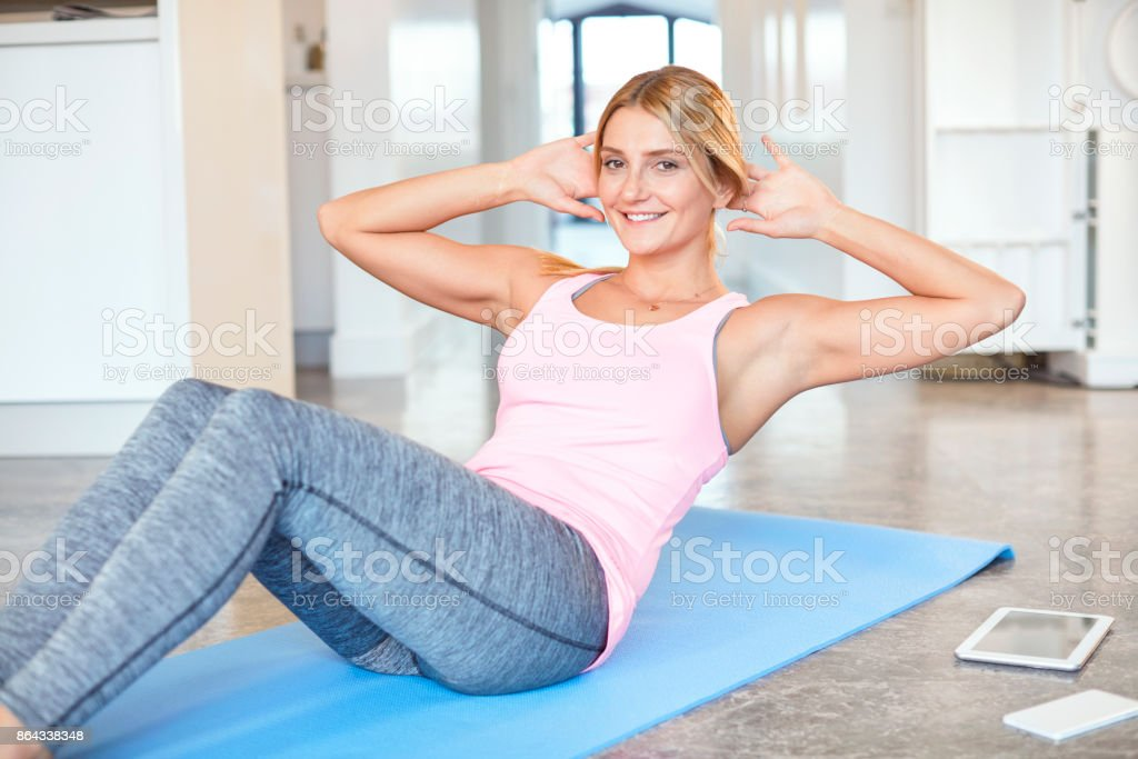 Young women making crunches stock photo
