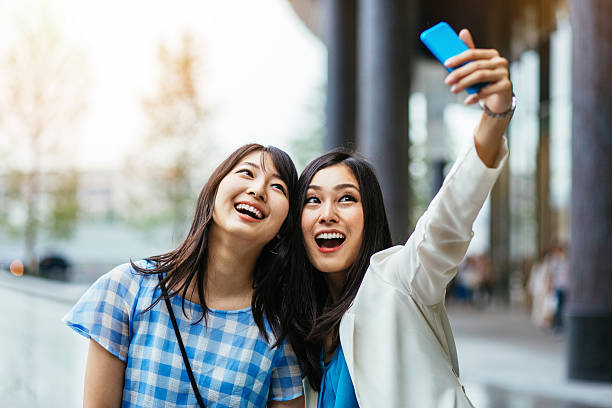 young women making selfie - self portrait photography stock pictures, royalty-free photos & images