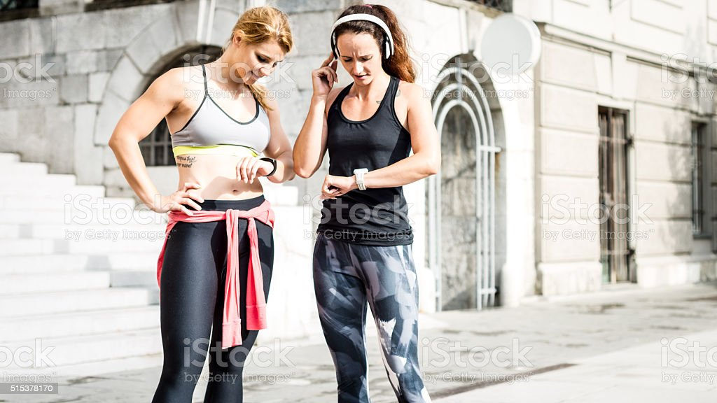 Young women measuring heart rate after running stock photo