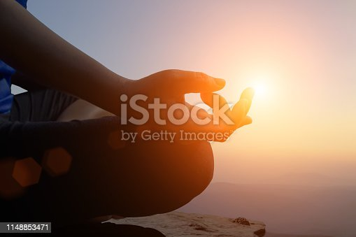 istock Young women meditate while doing yoga meditation. 1148853471