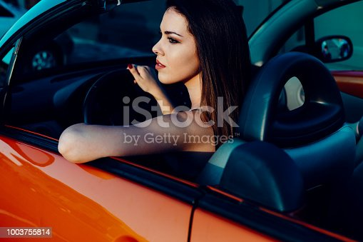 832085296 istock photo Young women on a road trip with cabriolet 1003755814