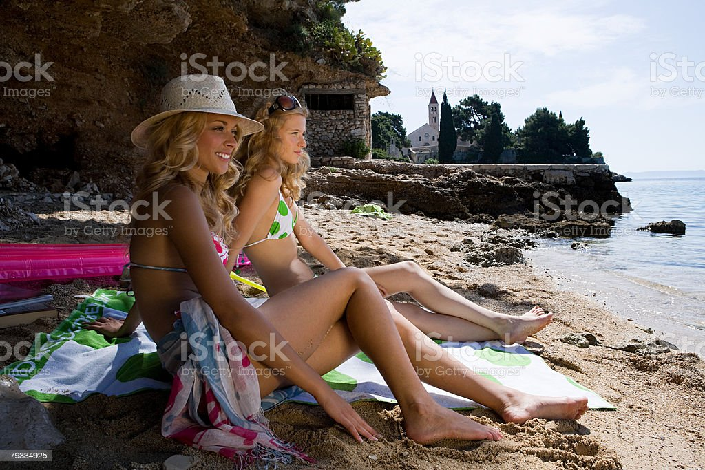 Young women on beach royalty-free stock photo
