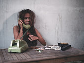 istock Young women on the phone for drug and heroine trade. Drug trafficking, crime, addiction and sale concept. 1041088984