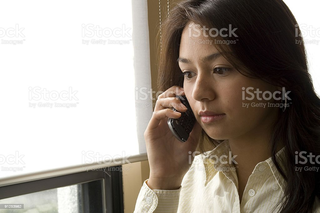 Young women on the phone stock photo