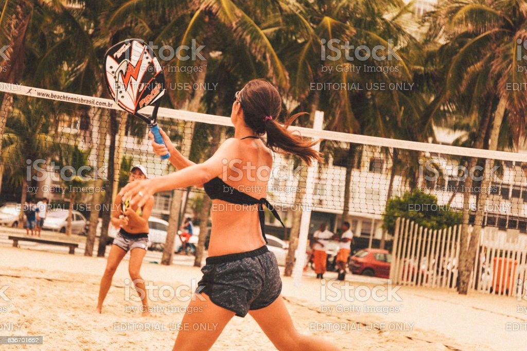 Young women playing beach tennis on Copacabana Beach - foto stock