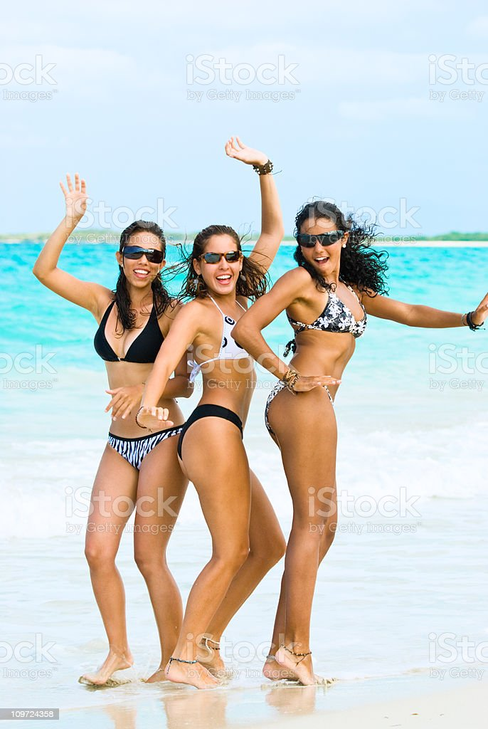 Young Women Posing and Dancing on Tropical Beach royalty-free stock photo