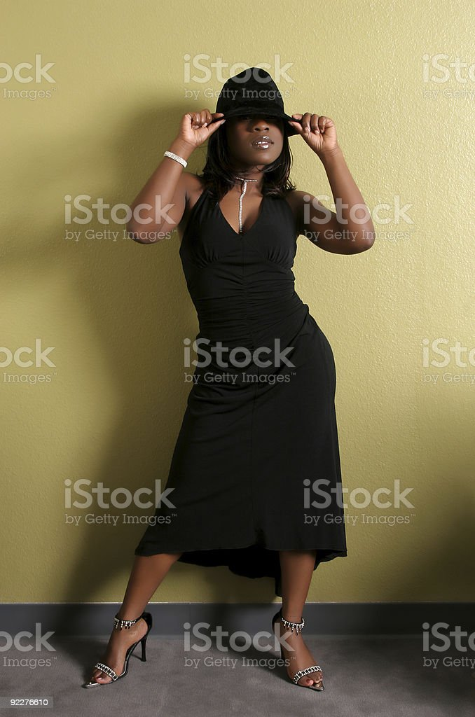 Young women posing with a hat on stock photo