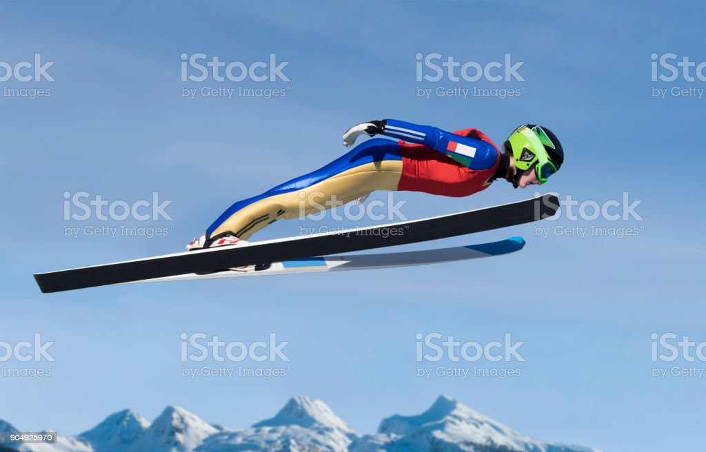 Young Women Practicing Ski Jumping stock photo