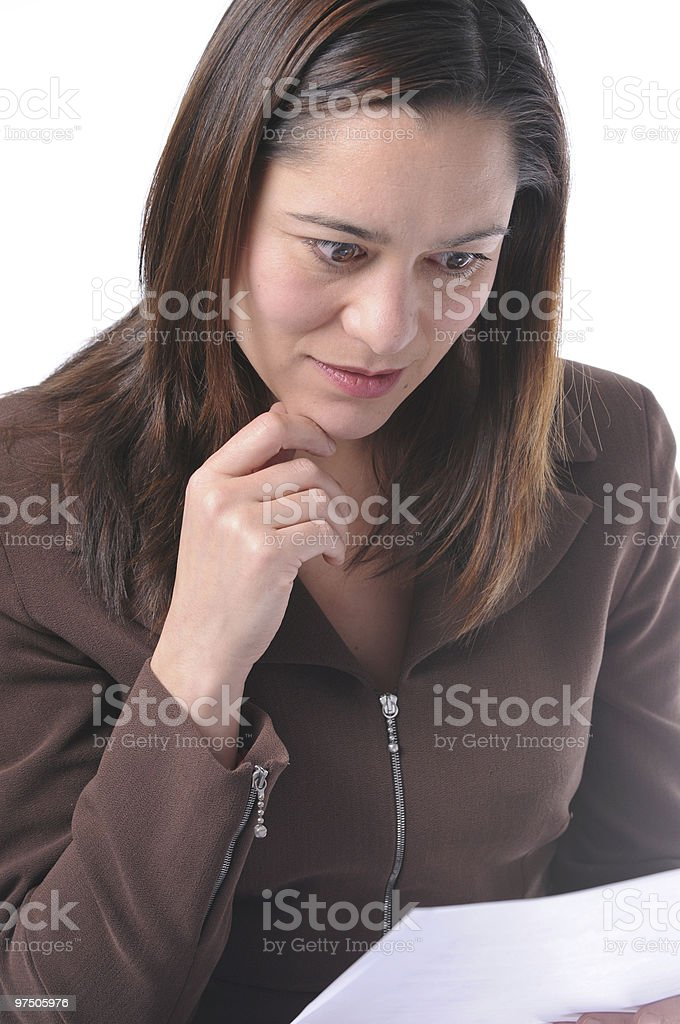 Young women reading a document. royalty-free stock photo