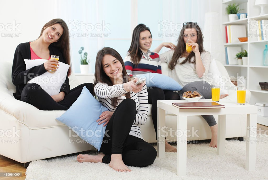 young women relaxing at home stock photo more pictures. Black Bedroom Furniture Sets. Home Design Ideas