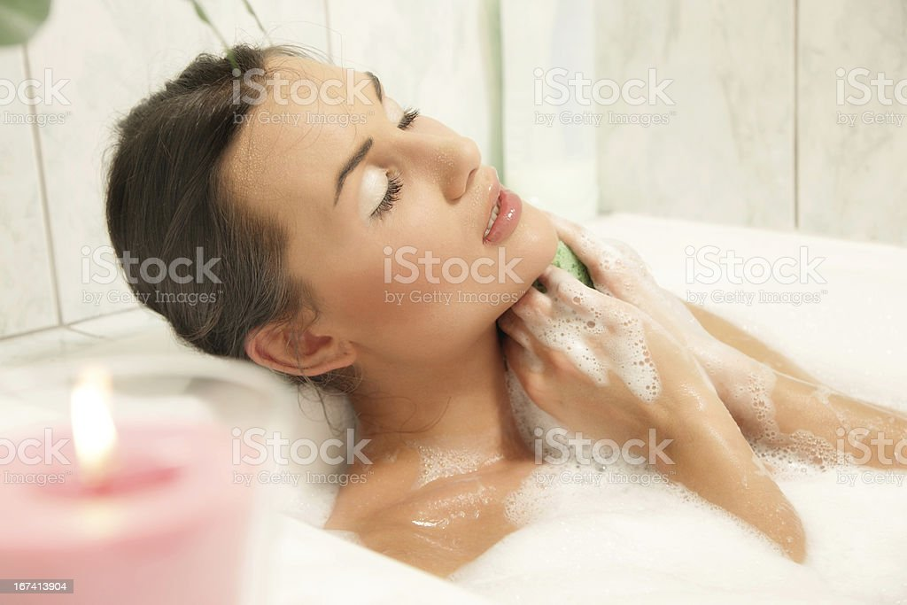 Young women relaxing in her bath royalty-free stock photo