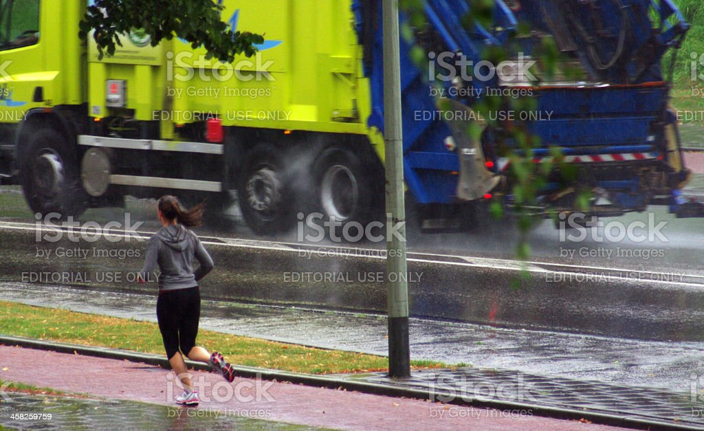 Young women running in the rain royalty-free stock photo