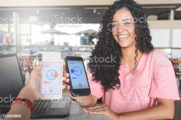 Young women sending money through digital wallet using wireless picture id1155949933?b=1&k=6&m=1155949933&s=612x612&h=g9fd gbxvpbrtmmtrcdj6uyuigjebempgerkqdsx 0g=