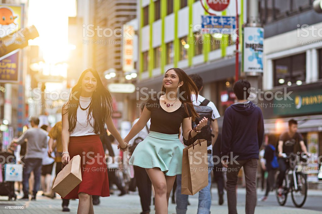 Young women shopping at sunset in Tokyo stock photo