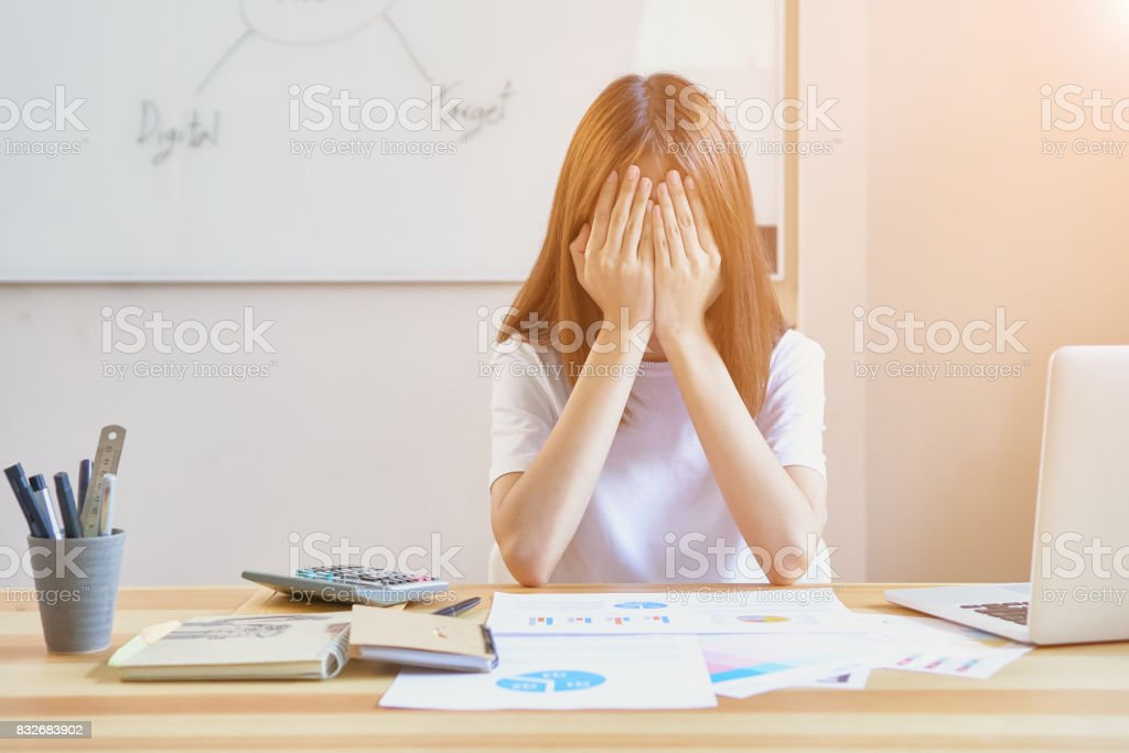 Young women show fatigue from hard work. And fearing that her work will not be completed to send customers. The concept does not work too hard, vintage effect. stock photo