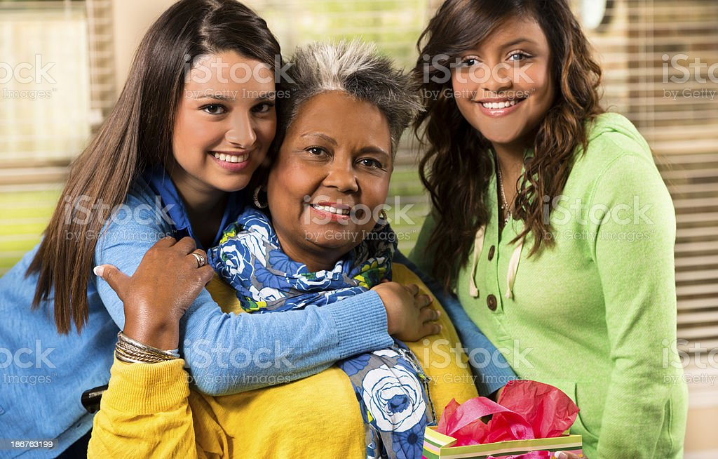 Young women smile and pose with senior woman royalty-free stock photo