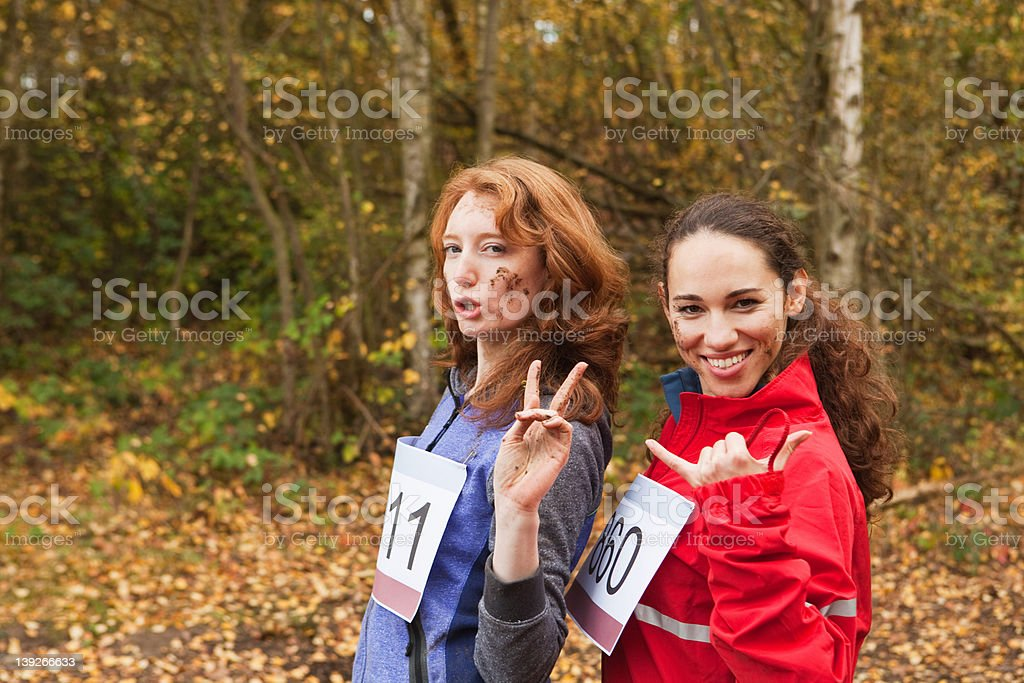 Young women smiling in forest, portrait stock photo