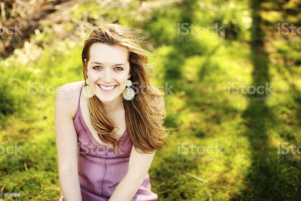 Young Women Smiling in Green Grass royalty-free stock photo
