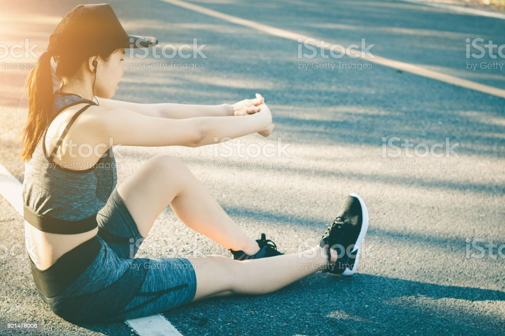 Young women stops resting after running. stock photo