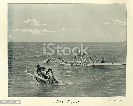 Vintage photograph of a Young women swimming in the sea, diving of wheeled platform, Victorian 19th Century