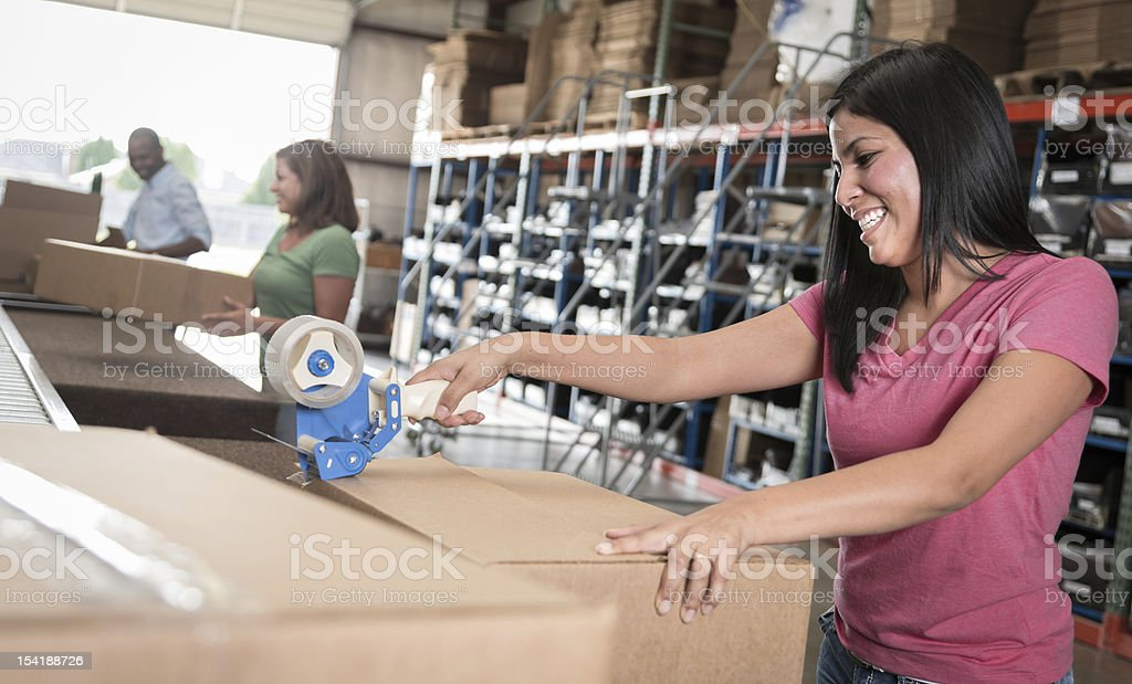 Young women taping a box royalty-free stock photo