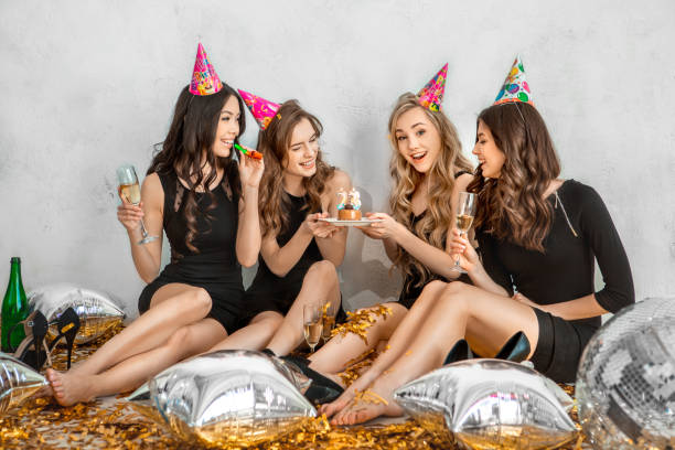 Young women together celebrating birthday isolated on white stock photo