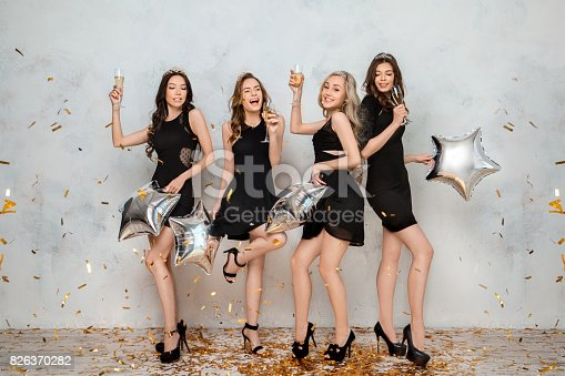 istock Young women together celebrating hen party isolated on white 826370282
