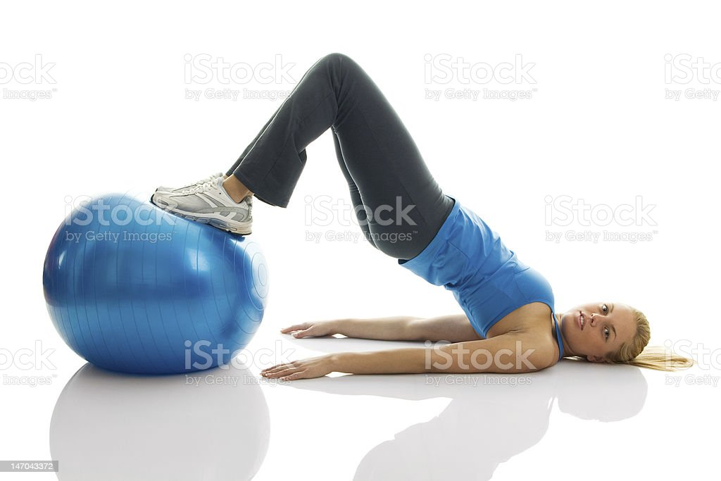 Young women training on a fitness ball royalty-free stock photo
