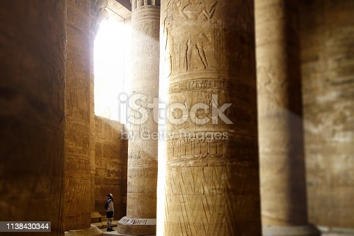 Women inside of Edfu Temple, proportion with massive columns