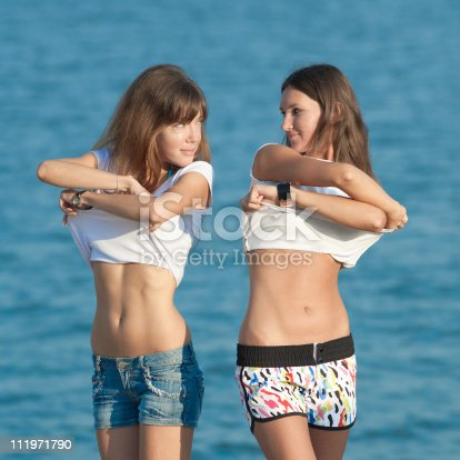 woman-undressing-young-girls