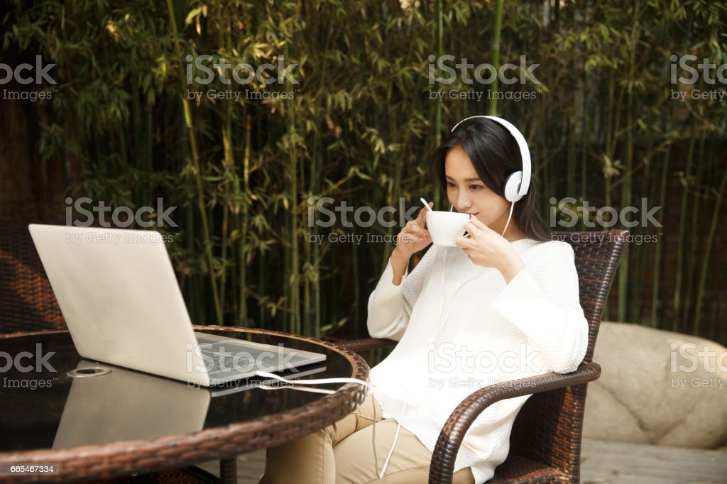 Young women use notebook computers stock photo