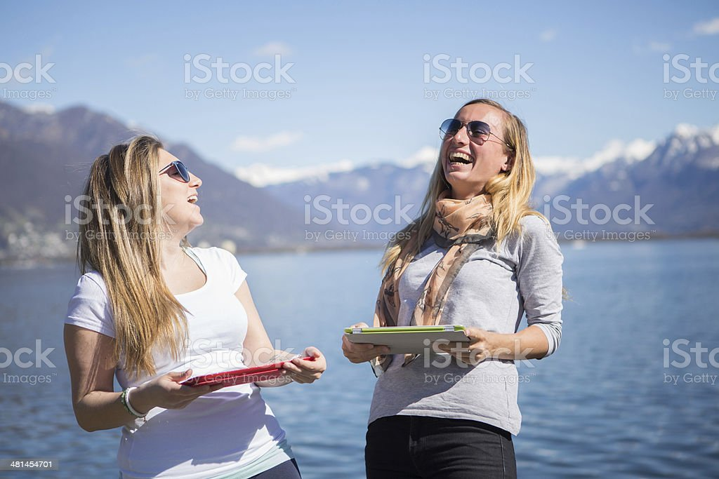Young women using digital tablets royalty-free stock photo