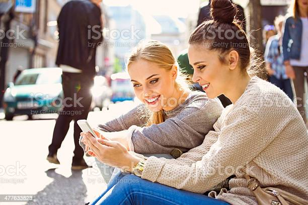 Young Women Using Smart Phone Stock Photo - Download Image Now