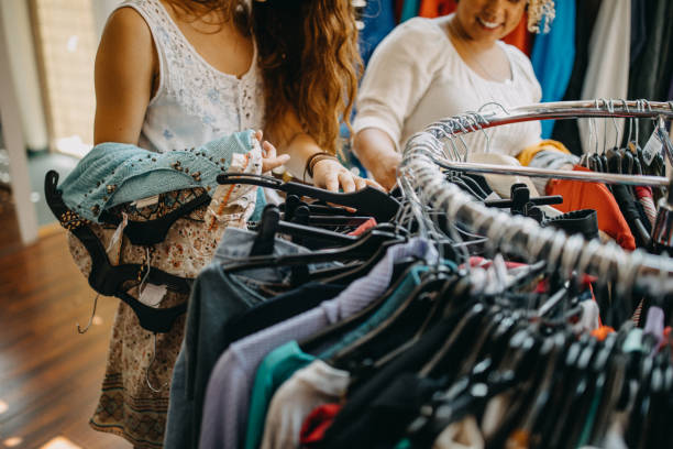 Young women vintage clothes shopping stock photo