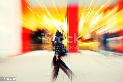 istock Young women walking down shopping street, blurred motion 171159315