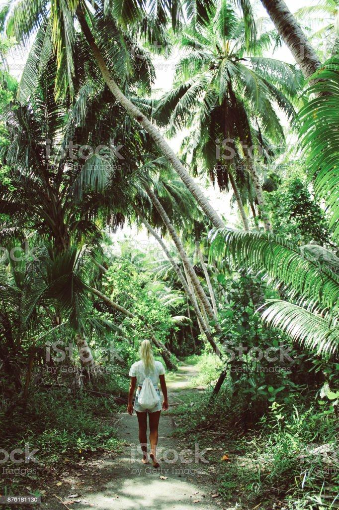 Young women walking trough jungle stock photo