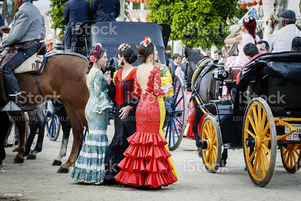 Young women wearing traditional flamenco dress at the Fair Seville stock photo