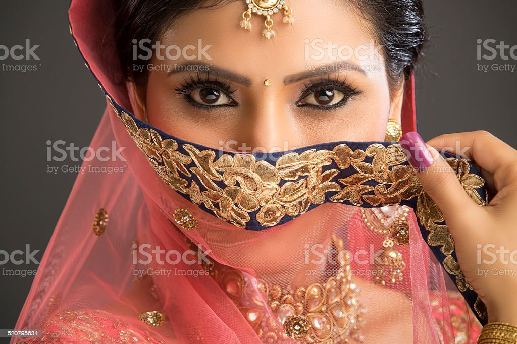 Young women with beautiful eyes in glamorous outfit stock photo