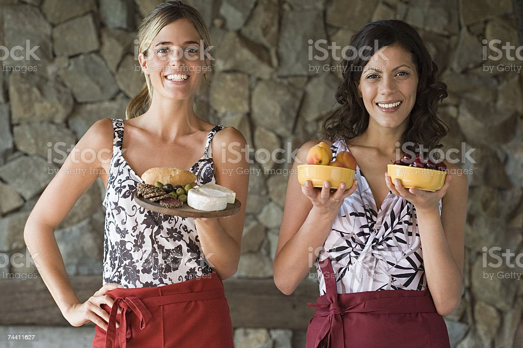 Young women with bowls of food royalty-free stock photo