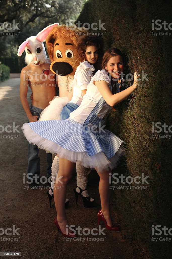 Young Women with Costumed Men stock photo
