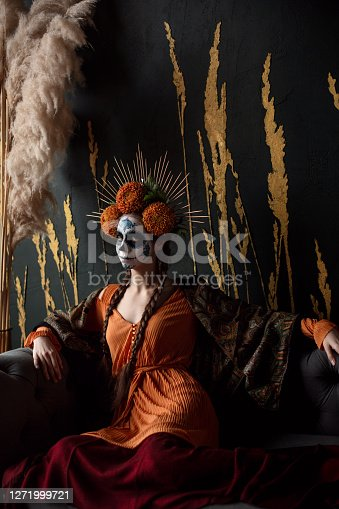 Woman's face with ceremonial make-up Sugar skull. Traditional Mexican Dia de los Muertos celebration