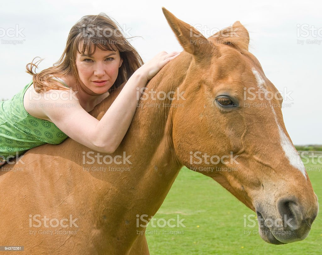 Young women with horse royalty-free stock photo