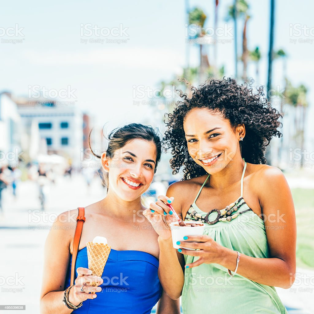 Young women with ice creams stock photo