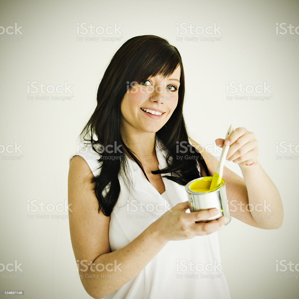 Young Women with paint pot royalty-free stock photo