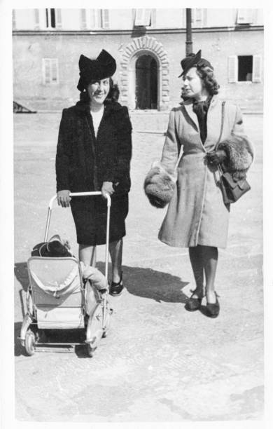 young women with pram in 1949. black and white.child - 1940s style stock photos and pictures