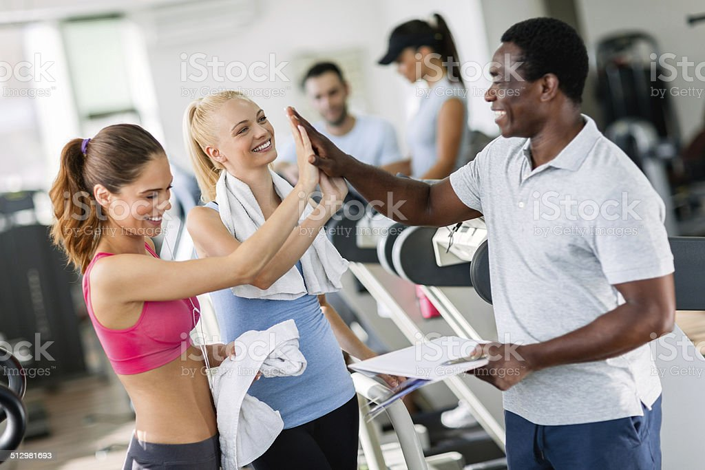Young women with trainer stock photo